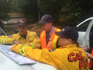 Dr. John Madigan, center, working with CalFire officials.