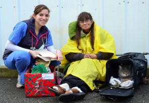 Rachel Ferris, a third year DVM student, delivers a holiday gift basket to a client at the Mercer Clinic for the Pets of the Homeless in Sacramento. The compassion shown to clients at the clinic brings them hope in times of difficulty.