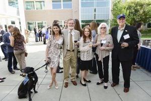 Dr. Anjolie Daryani ('15) with companion Ebony, Dennis and Virginia Engler, Nancy Ehrlich and Dr. Michael Floyd ('61).