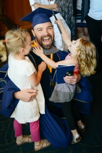 A recent graduate celebrates with his family.